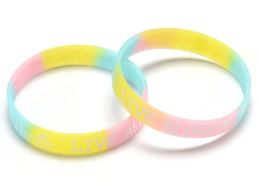 China Fixed Color Personalized Pink Rubber Bracelets Fashionable Custom Logo supplier